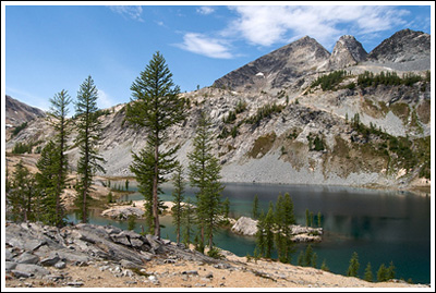 Larch, lake, campsite, and Mt. Maude.